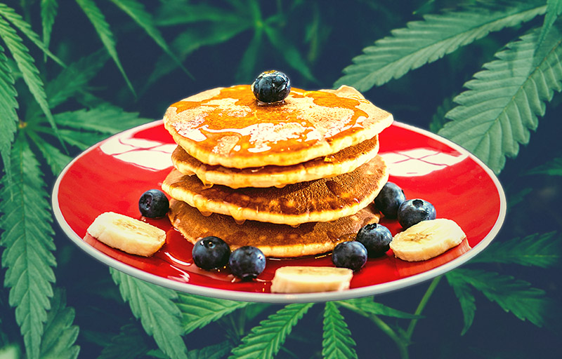 Pancake Breakfast In Front of Weed Background